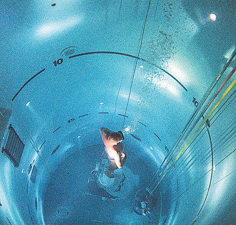 "Instructor performing a free ascent in the ""tank"" at the Submarine Escape Training Facility"