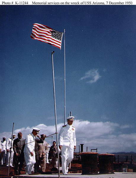 Admiral Arthur W. Radford, USN,<br /> Commander in Chief, Pacific, and CinC, Pacific Fleet<br /> <br /> Leads the procession during memorial services on board the wreck of USS Arizona (BB-39), 7 December 1950, on the 9th anniversary of the Japanese attack on Pearl Harbor.<br /> <br /> Official U.S. Navy Photograph, National Archives Collection.