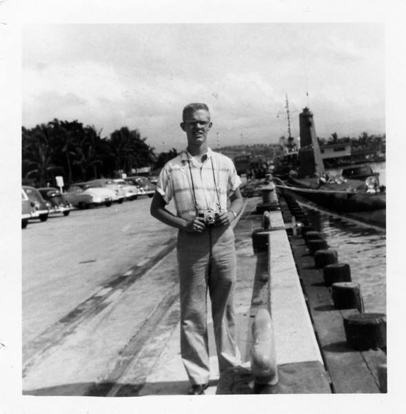 David C. Mellen TE(RM)3 - By the Sub Base submarine docking area, Pearl Harbor Hawaii.  Date of photo circa 1956.  Photo submitted by his sister Claudia.