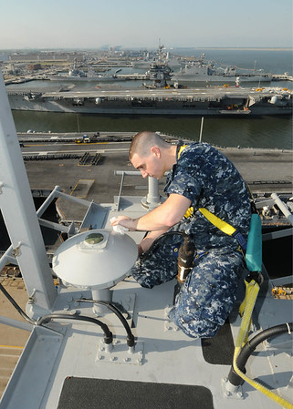 100506-N-6509M-007 NORFOLK, Va. (May 6, 2010) -- Electronics Technician 3rd Class Cory J. Boswell from USS George H.W. Bush (CVN 77) Combat Systems Department performs maintenance on a Global Positioning System more than 200 feet above the waterline May 6. George H.W. Bush is undergoing Command Assessment of Readiness and Training. (U.S. Navy photo by Mass Communication Specialist Seaman Daniel S. Moore)