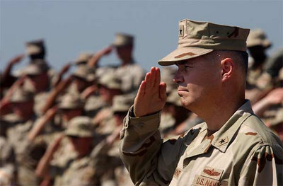 U.S. Navy Rear Adm. Richard W. Hunt salutes the Ensign during the playing of the National Anthem at the conclusion of the Combined Joint Task Force, Horn of Africa (CJTF HOA) change of command ceremony. Hunt relieved U.S. Marine Corps Maj. Gen. Timothy Ghormley as Commander CJTF-HOA at Camp Lemonier.
