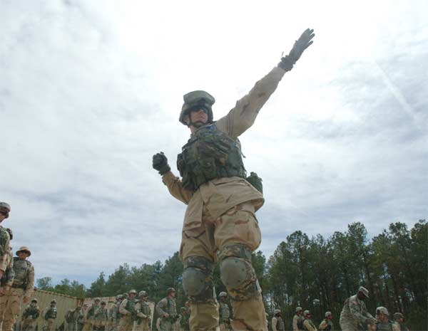 A Sailor launches a hand grenade during the Navy's Individual Augmentee Combat Training course at Fort Jackson, S.C.