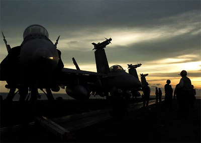 """F/A-18E Super Hornets assigned to the """"Kestrels"""" of Strike Fighter Squadron One Three Seven (VFA-137) sit on the flight deck prior to flight operations aboard USS Abraham Lincoln (CVN 72)."""