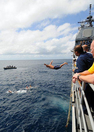 081216-N-1082Z-049 INDIAN OCEAN (Dec. 16, 2008) Cryptologic Technician (Technical) 2nd Class Jason Nicholas, from Gordo, Ala., jumps from the guided-missile cruiser USS Vella Gulf (CG 72) during a swim call. Vella Gulf is deployed as part of the Iwo Jima Expeditionary Strike Group supporting maritime security operations in the U.S. 5th Fleet area of responsibility. (U.S. Navy photo by Mass Communication Specialist 2nd Class Jason R. Zalasky/Released)