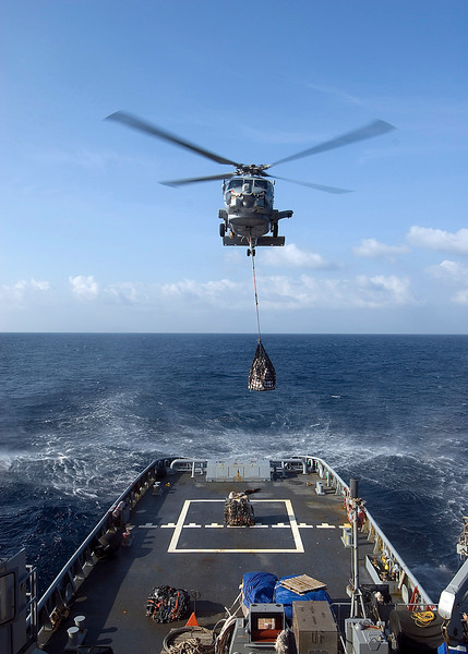 081203-N-0743B-019INDIAN OCEAN (Dec 3, 2008) An SH-60B Seahawk helicopter from Helicopter Anti-Submarine Squadron Light (HSL) 42 assigned to the guided-missile cruiser USS Vella Gulf (CG 72) lowers pallets onto the fantail of the Military Sealift Command fleet ocean tug USNS Catawba (T-ATF 168) during a vertical replenishment. (U.S. Navy photo by Mass Communication Specialist 1st Class Eric L. Beauregard/Released)