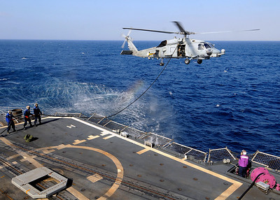 081119-N-1082Z-036 INDIAN OCEAN (Nov. 19, 2008) An SH-60B Sea Hawk from Helicopter Anti-Submarine Squadron Light (HSL) 42 conducts helicopter in-flight refueling aboard the guided-missile cruiser USS Vella Gulf (CG 72). Vella Gulf is deployed as part of the Iwo Jima Expeditionary Strike Group supporting maritime security operations in the U.S. 5th Fleet area of responsibility. (U.S. Navy photo by Mass Communication Specialist 2nd Class Jason R. Zalasky/Released)