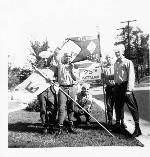 "Boot Camp CO 359 (Reading Left to Right) 1-Walter L. Traill 2-Raymond G. Rowland 3-Robert Wilson 4-Robert Lauer 5-Stephen P. Mateyak under sign - November 1955 (#197)<br /> <br /> Displayed left, is Company 359 ""E"" Flag.  Displayed right, is Company 359 Flag.  25th Battalion sign displayed under Company 359 Flag."