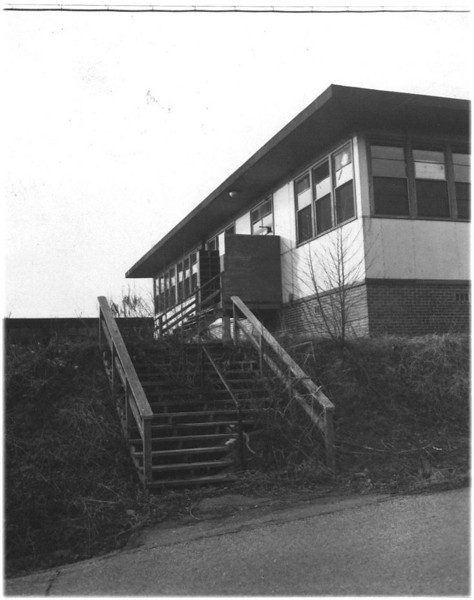 USNTC BAINBRIDGE - 1967 Photo of the beginning of the end of USNTC BAINBRIDGE with over growth and broken windows and doors.