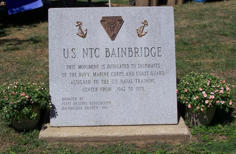 """Memorial Stone donated by Fleet Reserve Association, Bainbridge Branch 168.  Dedicated to """"USNTC BAINBRIDGE - This monument is dedicated to shipmates of the NAVY, MARINE CORPS and COAST GUARD assigned to the U.S. NAVAL TRAINING CENTER from 1942 to 1975."""""""