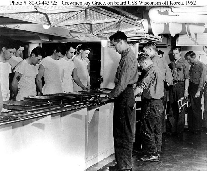 Crewmen onboard USS WISCONSIN - saying Grace before meal service.  1952 photo.