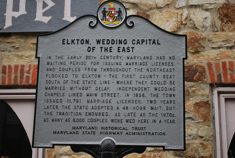 "When northern states began to pass more restrictive marriage laws in the early 20th Century, Maryland did not. As a result, a number of Maryland towns near borders with other states became known as places to get married quickly and without many restrictions, or ""Gretna Greens"".  Elkton, being the northeastern most county seat in Maryland (and thus closer to Philadelphia, New York, and New England), was particularly popular.  It was a notorious Gretna Green for years; in its heyday, in the 1920s and 1930s, it was ""the elopement capital of the East Coast"" and thousands of marriages were performed there each year.  <br /> <br /> While some of the marriages obtained in Elkton were of celebrities or celebrities-to-be (Cornel Wilde, Joan Fontaine, Debbie Reynolds, Martha Raye, John and Martha Mitchell, Willie Mays, and Pat Robertson all got married in Elkton), the overall tawdry flavor grew to be too much for the state. A 48-hour waiting period was imposed in 1938, but Elkton continued to be a place to marry, and especially elope; it simply took longer.  In time, Las Vegas became the new ""American Gretna Green,"" although hundreds of people are still married in Elkton each year.<br /> <br /> Bainbridge MD to Elkton MD is approximately 21 miles!"