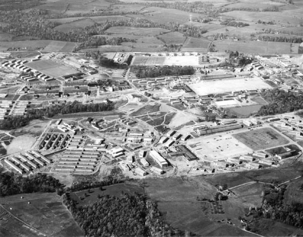 Aerial View of USNTC BAINBRIDGE Four Regimental Grinders.  Reading upper left to right. Camp Rodgers - 1st Regiment.  Camp Perry - 2nd Regiment.  Camp Barney - 4th Regiment.  Camp James - 3rd Regiment.  (WAVES - 1950's.  WAVES moved to 1st Regiment - 1970's).