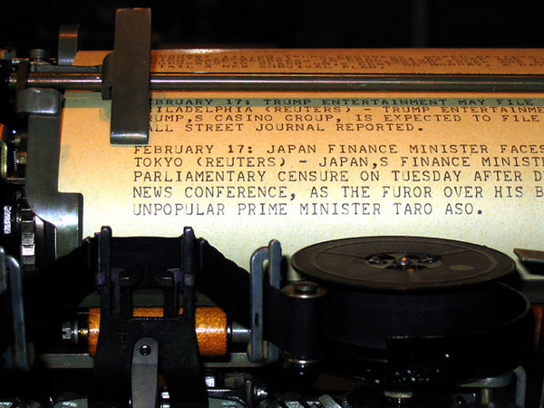 Closer look at page of typed messages on a Model 15 teletype machine.
