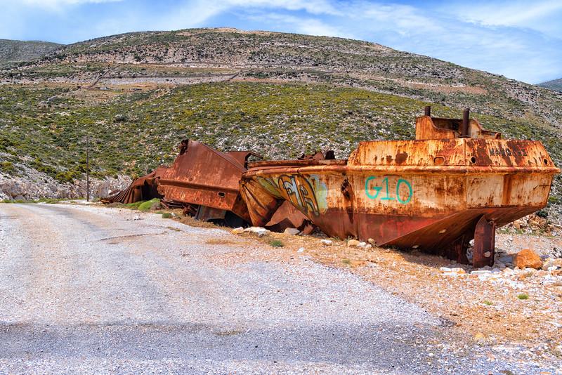 Old rusty boat half way up a mlountain on the road to Motusouna