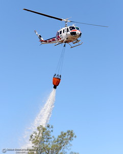 CAL FIRE Helicopter 205 makes a water drop during a fire training simulation at the Neal Indident drill in Paradise, Calif. Wed. June 22, 2016. (Bill Husa -- Enterprise-Record)