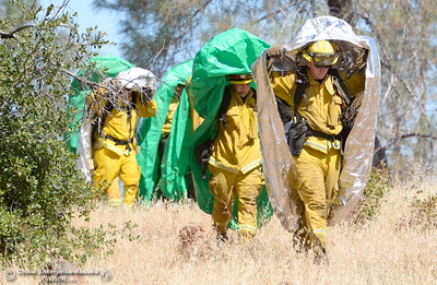 A group of firefighters are seen with fire shelters deployed after a mock burn over is practiced during a fire training simulation at the Neal Indident drill in Paradise, Calif. Wed. June 22, 2016. (Bill Husa -- Enterprise-Record)