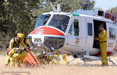 CAL FIRE Helicopter 205 deploys their bucket during a fire training simulation at the Neal Indident drill in Paradise, Calif. Wed. June 22, 2016. (Bill Husa -- Enterprise-Record)