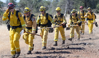 The crew of Vina Helitack copter 205 heads down a trail during a fire training simulation at the Neal Indident drill in Paradise, Calif. Wed. June 22, 2016. (Bill Husa -- Enterprise-Record)