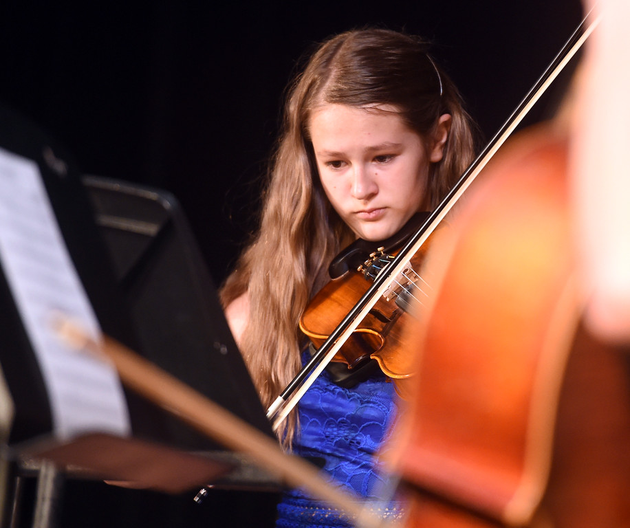 . Courtney Horton plays with the 8th grade orchestra at the Nederland Middle School 8th Grade Continuation Ceremony on Friday.  For more photos, go to www.dailycamera.com.  Cliff Grassmick  Staff Photographer May 26, 2017