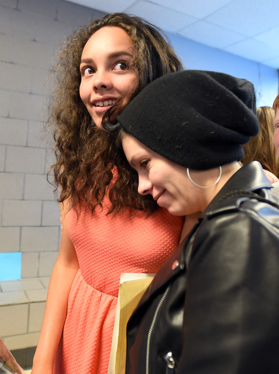 . Amiah Kaufman gets a hug from her mother, Tommi-Lee Kaufman, after the Nederland Middle School 8th Grade Continuation Ceremony on Friday.  For more photos, go to www.dailycamera.com.  Cliff Grassmick  Staff Photographer May 26, 2017