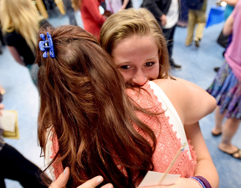 . Sydney Nation hugs her mother Suzi Lorenz at the Nederland Middle School 8th Grade Continuation Ceremony on Friday.  For more photos, go to www.dailycamera.com.  Cliff Grassmick  Staff Photographer May 26, 2017