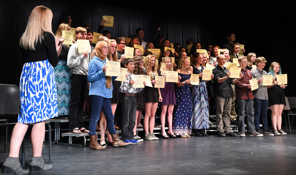 . Former 8th-graders hold up their certificates for a photo at the Nederland Middle School 8th Grade Continuation Ceremony on Friday.  For more photos, go to www.dailycamera.com.  Cliff Grassmick  Staff Photographer May 26, 2017