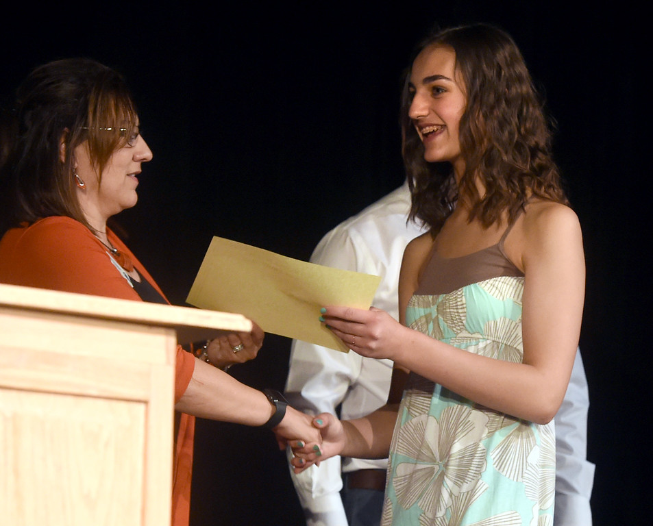 . Maya Beauvineau  receives her certificate at the Nederland Middle School 8th Grade Continuation Ceremony on Friday.  For more photos, go to www.dailycamera.com.  Cliff Grassmick  Staff Photographer May 26, 2017