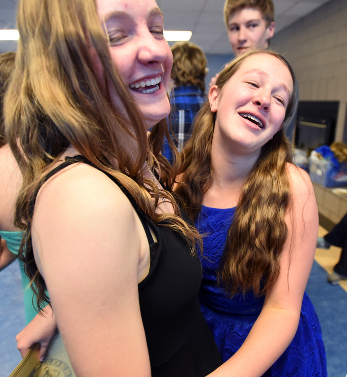 . Rylee Kutscher, left, and her friend, Courtney Horton, become emotional at the Nederland Middle School 8th Grade Continuation Ceremony on Friday.  For more photos, go to www.dailycamera.com.  Cliff Grassmick  Staff Photographer May 26, 2017