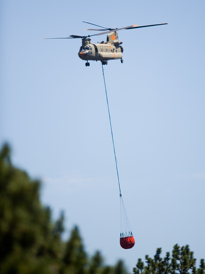 "A helicopter carries water from the Barker Reservoir which will be used to battle the Cold Springs Fire on Sunday.<br /> More photos:  <a href=""http://www.dailycamera.com"">http://www.dailycamera.com</a><br /> (Autumn Parry/Staff Photographer)<br /> July 10, 2016"