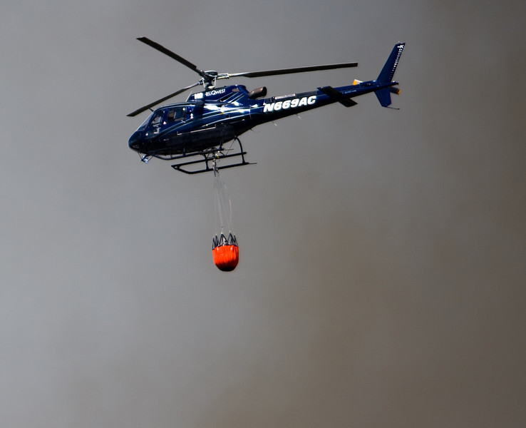 "A helicopter delivers buckets of water to help fight the fire near Barker Reservoir in Nederland on Saturday.<br /> More photos:  <a href=""http://www.dailycamera.com"">http://www.dailycamera.com</a><br /> (Autumn Parry/Staff Photographer)<br /> July 9, 2016"