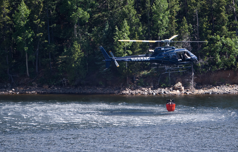 "A helicopter gathers water from Barker Reservoir to help fight the fire in Nederland on Saturday.<br /> More photos:  <a href=""http://www.dailycamera.com"">http://www.dailycamera.com</a><br /> (Autumn Parry/Staff Photographer)<br /> July 9, 2016"