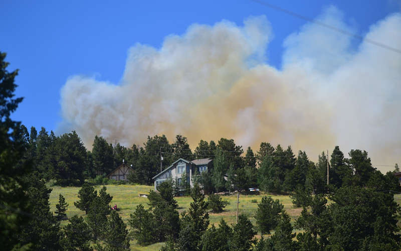 "A fire threatens a home near Barker Reservoir in Nederland on Saturday.<br /> More photos:  <a href=""http://www.dailycamera.com"">http://www.dailycamera.com</a><br /> (Autumn Parry/Staff Photographer)<br /> July 9, 2016"