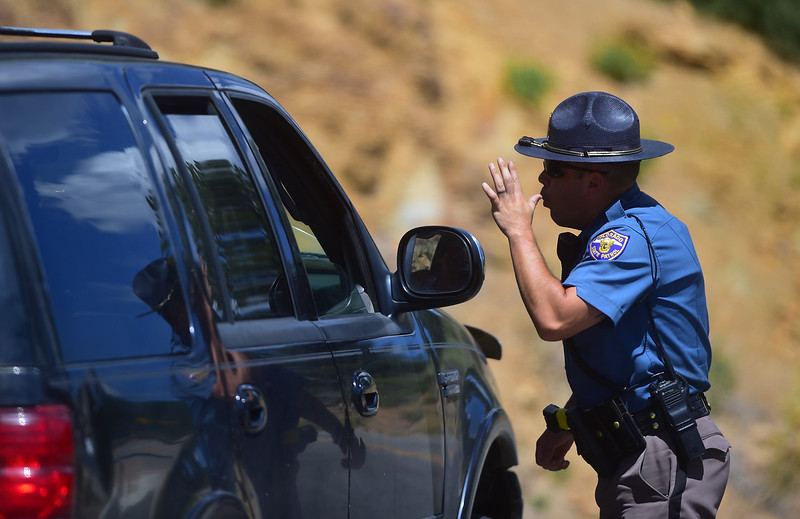 "An officer directs traffic away from Hurricane Hill Dr. as a  fire spreads near Barker Reservoir in Nederland on Saturday.<br /> More photos:  <a href=""http://www.dailycamera.com"">http://www.dailycamera.com</a><br /> (Autumn Parry/Staff Photographer)<br /> July 9, 2016"