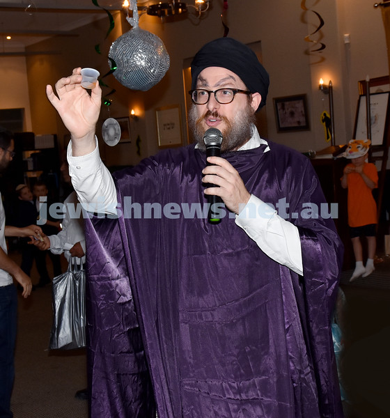 Purim at Nefesh Synagogue. Rabbi Aron Moss says L'Chaim. Pic Noel Kessel