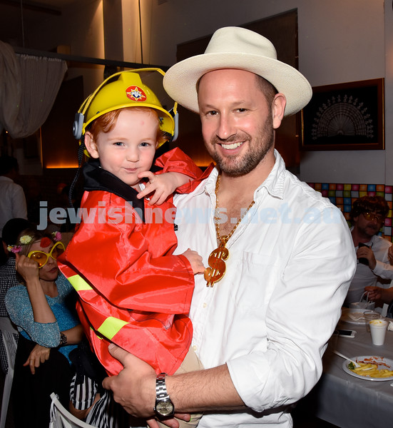 Purim at Nefesh Synagogue. Amiel Gold (left) with his father Larnce. Pic Noel Kessel