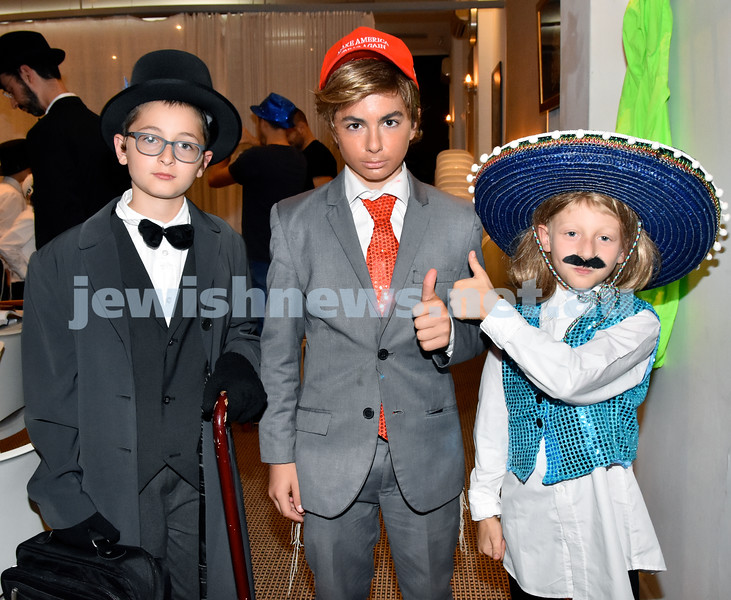 Purim at Nefesh Synagogue. From left: Yisroel Moss, Shloime Slavin, Josh Duncan Andrews. Pic Noel Kessel