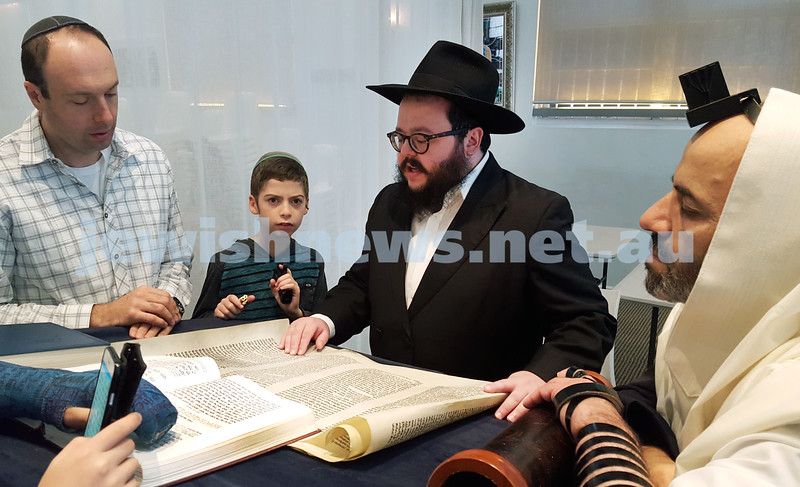 Purim at Neshesh - Rabbi Chanoch Sufrin reads the Megilah. Pic Noel Kessel.