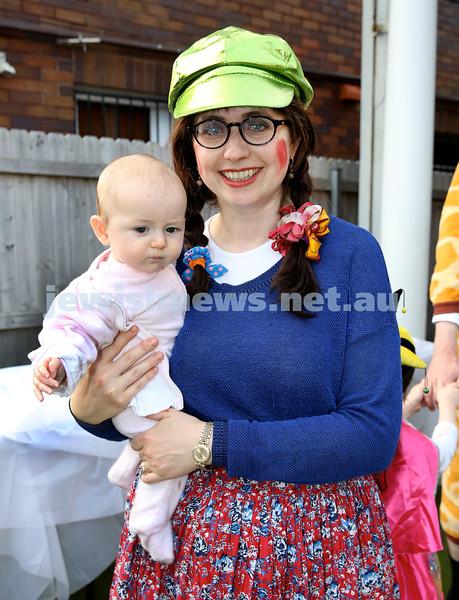 Kids Purim Party at Nefesh. Nechama Dina Moss with baby Rivka. Pic Noel Kessel.