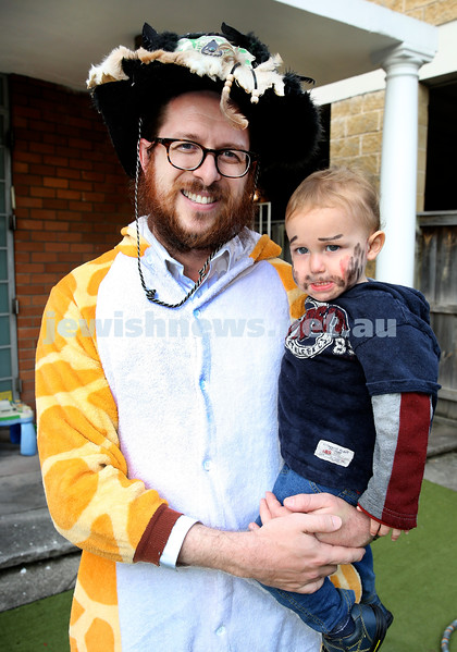 Kids Purim Party at Nefesh. Rabbi Aaron Moss with his son Meir. Pic Noel Kessel.