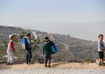 Children in Netiv Avot gaze at the view.