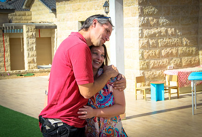 David and Yael den Heijer made aliyah from Holland in 1997. They have five children, ages 3 to 11. They've been living in Elazar for over 13 years. There is a one meter strip of one room that is on the disputed land (the area just behind them). Note the red lines on their neighbor's house on the left, marking the strip of home that runs right through the center of their home.