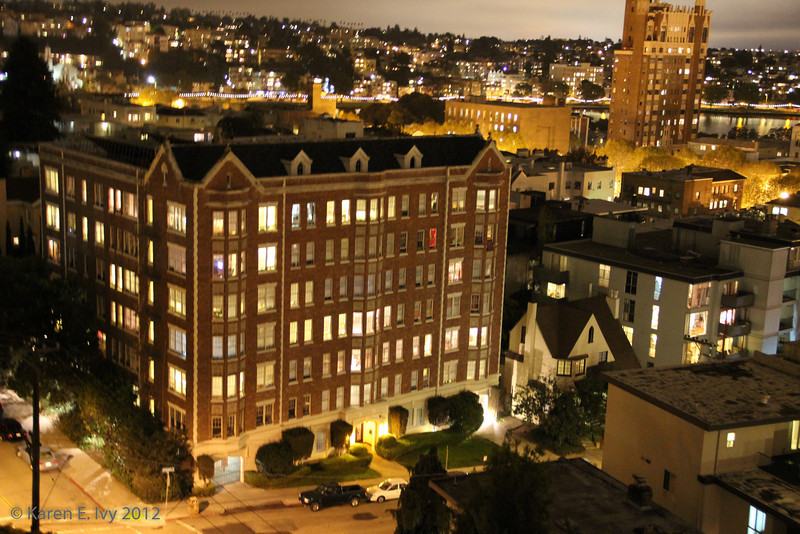 Adams Point apartments at night