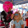 Jocey Cutshall, 3, of Chloe, W. Va., gets her face painted at the Apple Festival on Friday afternoon.