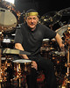 OXNARD, CA-MAY 12: Neil Peart poses with his DW drum kit on the Drum Channel soundstage in Oxnard, CA on May 12, 2010. (Photo by Clayton Call/Redferns)