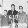 Allan, Neil, Frank Loomer with Grey Cup 1964<br /> First time BC won the Cup, Hymie was a friend of the engraver (Barry) and we went to his shop where he was engraving the name on the trophy.