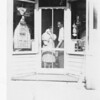 Ethel holding baby=probably Roy - with Abe in Bruderheim store