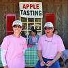 This couple worked at the apple tasting table.