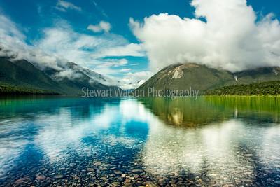 Stunning reflections on the transparant water of Lake Rotoiti Nelson New Zealand