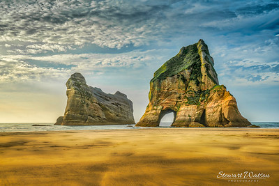 The Archway Islands are a group of rock stacks off Wharariki Beach on New Zealand's South Island near Puponga