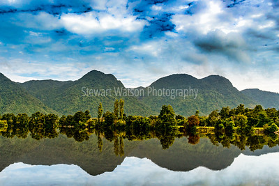 Mirror image reflections of the mountains and the skies